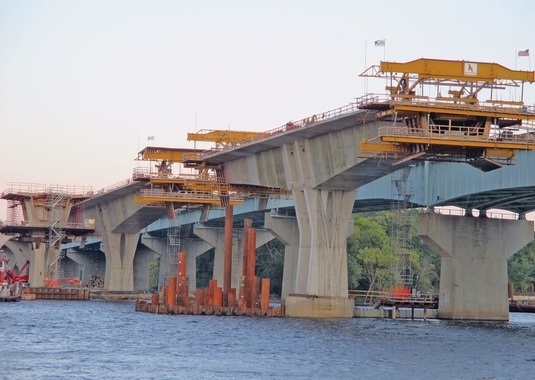 September, 2014: The Desbach Bridge's variable depth concrete segmental superstructure crosses the Mississippi River with 508' spans. (Photo Courtesy of FIGG).