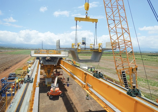 August 8, 2014: Typical 125' simple spans built span-by-span with top down construction crane on the deck, East Kapolei, Oahu. (Photo Courtesy of FIGG)