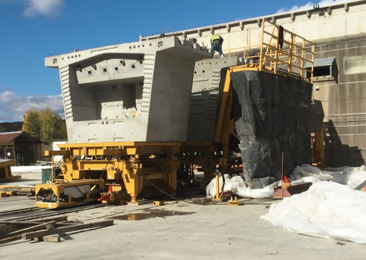 Railroad pier segments precast in two halves. The forms for the second segment half have been loosened so that the segment can be removed. (Photo Courtesy of FIGG).